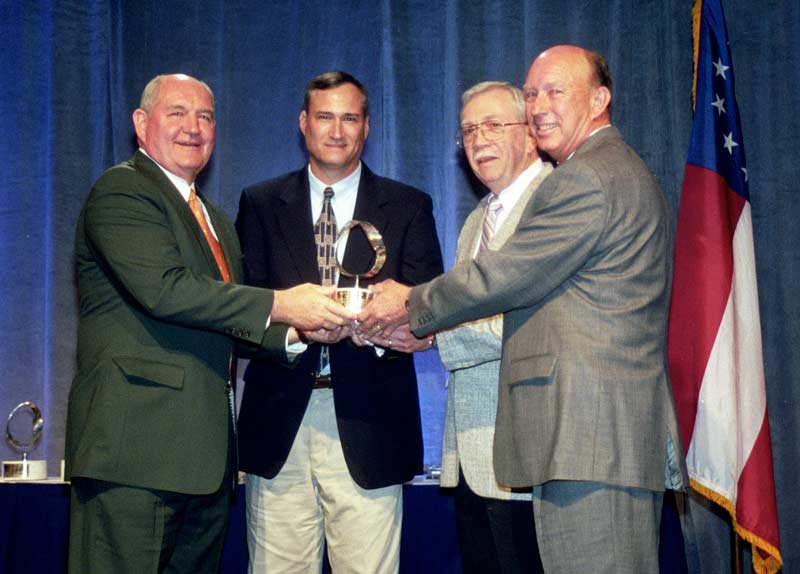 DIFCO owners receive the Manufacturer of the Year Award.